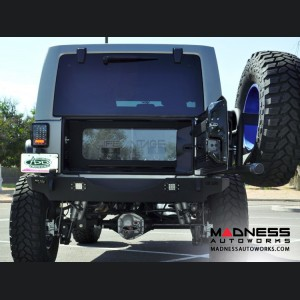 Jeep Wrangler JK Hinged Stealth Fighter Tire Carrier by Addictive Desert Designs - 2007+